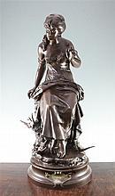 Auguste Louis Mathurin Moreau (French, 1834-1917). A large patinated bronze, 'Retour des Hirondelles', 27in.