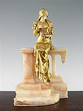 Dominique Alonzo (French, fl.1910-1930)., A gilt bronze and ivory figure, 'The Jewel Box', 15.5in,