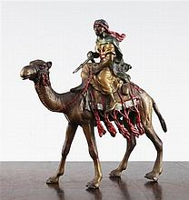 An Austrian cold painted bronze figure of an Arab fighter riding a camel, 5.5in.