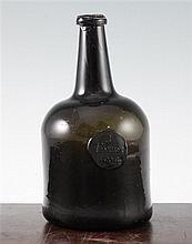 A George III sealed mallet shaped wine bottle, J.Trezise, 1764, 22cm