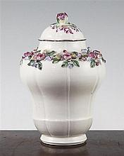 A Mennecy porcelain floral encrusted ogee-shaped vase and cover, c.1760, 17.5cm