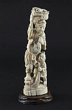 A Japanese walrus ivory group of a fisherman and a boy, early 20th century 21.5cm, wood stand