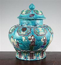 A Chinese Fahua decorated baluster jar and cover, 18th / 19th century, 32cm