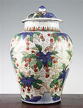 A Chinese wucai ovoid jar and cover, late 17th century, 37.5cm