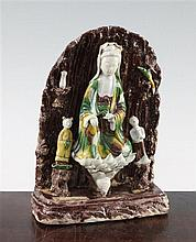 A Chinese Sancai glazed biscuit shrine of Guanyin, Kangxi period, 20.5cm
