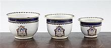 An unusual set of three graduated Chinese export enamelled porcelain flower pots, early 19th century, largest 11.5cm