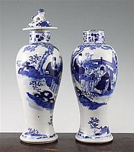 Two Chinese blue and white baluster vases and a cover, late 19th century, 28cm