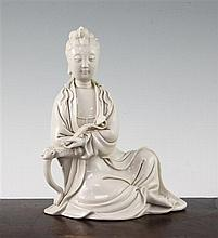 A Chinese blanc de chine seated figure of Guanyin, 20th century, 20.5cm