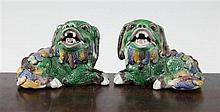 A pair of Chinese famille verte glazed biscuit figure of recumbent lion-dogs, 19th century, 10cm