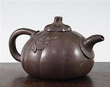 A Chinese Yixing melon-shaped teapot and cover, 19th / 20th century, length 18cm