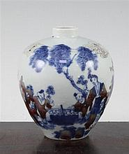 A Chinese underglaze blue and copper red small ovoid vase, Kangxi six character mark, early 20th century, 12cm