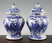 A pair of Chinese blue and white jars and covers, late 19th century, 28cm