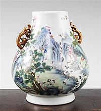 A Chinese famille verte pear shaped vase, Hu, 21cm