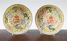 A pair of Chinese enamelled porcelain 'nine dragon' bowls, Republic period, 21cm