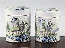 Two Chinese famille rose cylindrical jars and covers, 13cm and 13.5cm