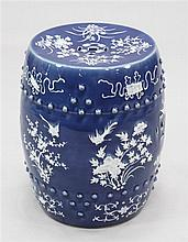A Chinese blue ground white slip decorated barrel shaped garden seat, late 19th century, 46.5cm