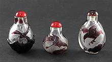 Three Chinese overlaid glass snuff bottles, 4.3 - 6.2cm
