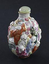 A Chinese moulded famille rose 'eighteen luohan' snuff bottle, Qianlong seal mark, 1820-1850, 7.4cm