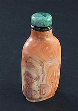 A Chinese coral snuff bottle, 1800-1900, 5.7cm, filler to natural faults