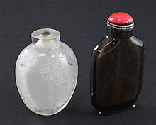 A Chinese rock crystal snuff bottle and a smoky quartz snuff bottle, 19th / 20th century, 7cm