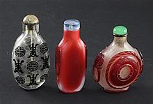 Three Chinese overlaid glass snuff bottles, 1850-1950, 6.6cm