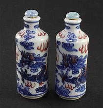 A pair of Chinese underglaze blue and copper red 'dragon' snuff bottles, 20th century, 8.6cm