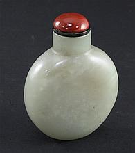 A Chinese pale celadon and russet jade snuff bottle, 6.5cm