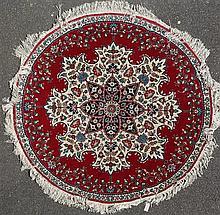 A circular Persian rug, diameter 5ft 9in.