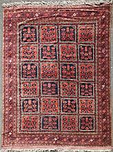 An early 20th century Afghan carpet, 11ft 4in by 8ft 4in.
