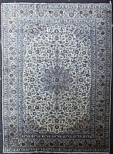 A Kashan carpet, 13ft 2in by 9ft 8in.