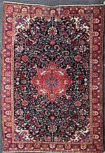 A Heriz carpet, 10ft 9in by 7ft 5in.