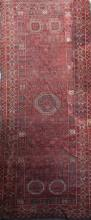 A large Persian carpet, 20ft 8in by 8ft 6in.