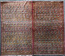 A pair of Kirman rugs, retailed by Liberty, 7ft 6in by 4ft 7in.