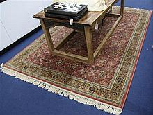 A Persian style hunting rug, 9ft 8in by 6ft 7in.