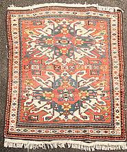 A Kazak rug, 6ft by 4ft 10in.