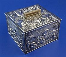 A 20th century Dutch? repousse silver mounted wooden cigarette box and cover, 4.5in.