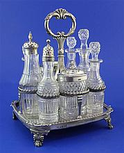 A George III silver cruet stand with eight cut glass bottles, overall height 9.5in.