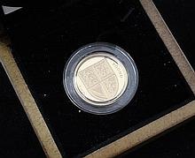 A cased Royal Mint 2008 Royal Shield of Arms £1 gold proof coin,