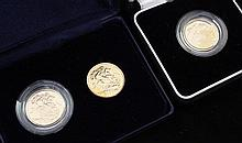 A cased pair of Royal Mint 2000 gold full sovereigns and a cased 2005 gold full sovereign,