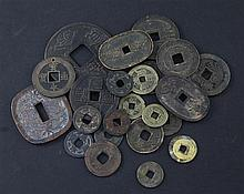A collection of Japanese mon and half-shu coins and Chinese bronze and copper coins, 15th-19th century (23)
