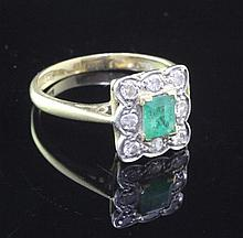 A mid 20th century 18ct gold and platinum, emerald and diamond cluster ring,