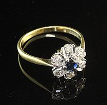 An 18ct gold, sapphire and diamond cluster ring, size Q.