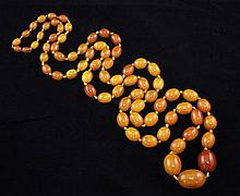 A single strand graduated oval amber bead necklace, 48in.