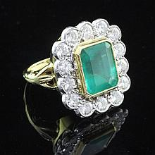 An unmarked gold, emerald and diamond cluster ring, size K.