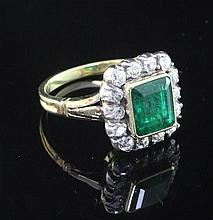 A Victorian style unmarked gold, emerald and diamond set cluster ring, size L.