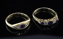 Two early 20th century 18ct gold, diamond and sapphire rings, sizes M & P.
