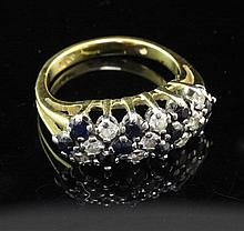 An 18ct gold, sapphire and diamond ring, size L.