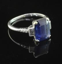 A mid 20th century platinum, sapphire and diamond ring, size 0.