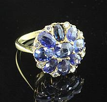 An 18ct gold sapphire and rose cut diamond cluster ring, size I.