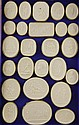 A collection of Italian Grand Tour plaster cameos, each tray 13in.